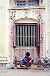 A boy spins silk  at a silk factory near Mandalay, Myanmar.