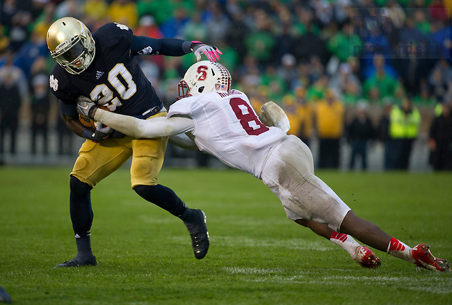 Oct. 13, 2012; Notre Dame running back Cierre Wood is tackled by Stanford safety Jordan Richards during the third quarter at Notre Dame Stadium. Photo by Barbara Johnston/University of Notre Dame