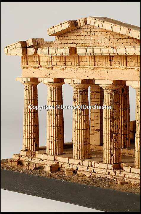 BNPS.co.uk (01202 558833)<br /> Pic: DukesOfDorchester/BNPS<br /> <br /> What a corker...<br /> <br /> The owner of a cork model of an ancient Greek temple are reaching for the champagne today after it sold for a whopping &pound;40,000.<br /> <br /> The 2ft scaled down version of the Temple of Neptune in Paestum was bought by the current owner's great-great-grandfather on a Grand Tour during the 1820s.<br /> <br /> The unnamed owner kept her relative's extravagant souvenir - which would have cost a few pounds in the early 19th Century - on display in a glass case in her living room for the last 30 years.