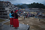 Two Tectitec Mayan girls watch over the celebrations in the ancient Mayan site of Zaculeu marking the end of the Mayan Era known as 13 Baktun. Zaculeu, Huehuetenango, Guatemala. December 21, 2012.