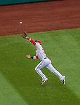 4 April 2014: Washington Nationals outfielder Bryce Harper reaches out to get a Jason Heyward slicing drive for the first out in the first inning against the Atlanta Braves during the Nationals Home Opening Game at Nationals Park in Washington, DC. The Braves edged out the Nationals 2-1 in their first meeting of the 2014 MLB season. Mandatory Credit: Ed Wolfstein Photo *** RAW (NEF) Image File Available ***