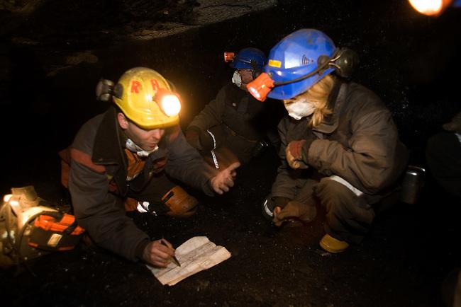 Tour leader Steve explains the mining method on the working coal mine tour of Mine 7. Spitsbergen