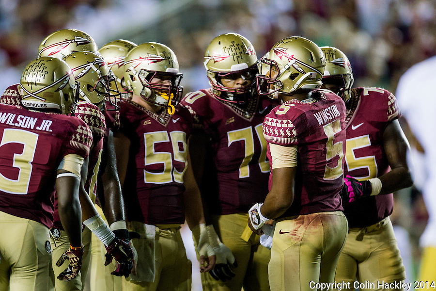 TALLAHASSEE, FLA. 10/18/14-FSU-ND101814CH-Florida State quarterback Jameis Winston, right, in the huddle with his team against Notre Dame during first half action Saturday at Doak Campbell Stadium in Tallahassee. <br /> COLIN HACKLEY PHOTO