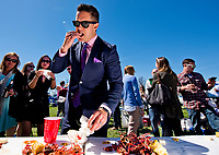 LEXINGTON, KENTUCKY - APRIL 08: A fans enjoys a crawfish during a crawfish boil on The Hill on Blue Grass Stakes Day at Keeneland Race Course on April 8, 2017 in Lexington, Kentucky. (Photo by Scott Serio/Eclipse Sportswire/Getty Images)