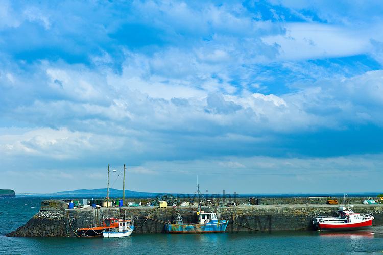 Fishing boats at Kilbaha quay harbour and bay, County Clare, West Coast of Ireland
