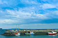 Fishing boats at Kilbaha quay harbour and bay, County Clare, West Coast of Ireland