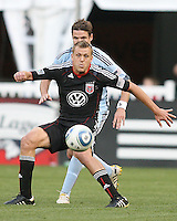 Adam Cristman #7 of D.C. United shields the ball from Drew Moor #3 of the Colorado Rapids during an MLS match on May 15 2010, at RFK Stadium in Washington D.C. Colorado won 1-0.