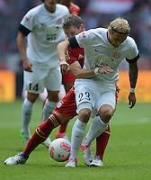 FUSSBALL   1. BUNDESLIGA  SAISON 2012/2013   3. Spieltag FC Bayern Muenchen - FSV Mainz 05     15.09.2012 Bastian Schweinsteiger (li, FC Bayern Muenchen) gegen Marcel Risse (1. FSV Mainz 05)