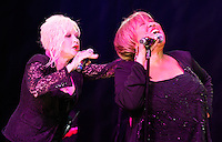 CLEVELAND - MAY 14:  Cyndi Lauper (left) and Mavis Staples (right) perform during the Rock and Roll Hall of Fame 'It's Only Rock And Roll' benefit concert and Women Who Rock exhibit opening concert at the Cleveland Convention Center on Saturday May 14, 2011 in Cleveland, Ohio.  (Photo by Jared Wickerham/Jared Wickerham/Getty Images for Rock and Roll Hall of Fame and Museum)