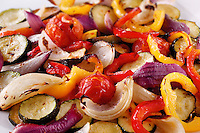 Mixed roast vegetables, onions, peppers and courgette food photos