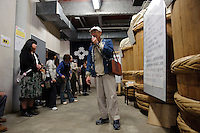 A member of staff guides guests around the room where the miso is made, Ishii Miso, Matsumoto, Japan, May 19, 2009. The miso company, founded in 1868, uses Japanese soy beans and wooden barrels to make premium miso aged for up to three years.
