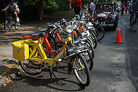 Velosolex lined up ready to go. Members of the Greater New York Citorën and Velosolex Touring Club bring out their lovingly restored Citroën automobiles for their Bastille Day Rendez-Vous, seen on Riverside Drive in New York on Sunday, July 14, 2013. The parade of over a dozen Citroëns, including 2CV, DB series models, a truck and a traction avant started on Riverside Drive and traveled through the streets of Manhattan. The owners are dedicated to restoring and caring for their vehicles and share tips and information on repairing and restoring them. (© Frances M. Roberts)