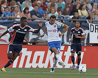 Montreal Impact forward Davy Arnaud (22) passes the ball as New England Revolution midfielder Clyde Simms (19) closes. In a Major League Soccer (MLS) match, Montreal Impact defeated the New England Revolution, 1-0, at Gillette Stadium on August 12, 2012.