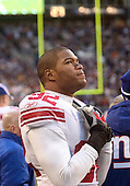 27 Nov 2005:   New York Giants Michael Strahan waits on the sidelines during a break in the action against the Seattle Seahawks at Quest Field in Seattle, WA.