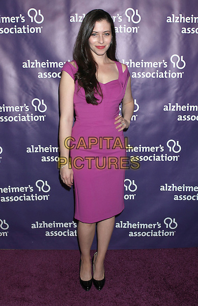 "Lauren Miller.21st Annual ""A Night At Sardi's"" Gala Benefiting The Alzheimer's Association Held At Beverly Hilton Hotel, Beverly Hills, California, USA..20th March 2013..full length dress pink purple cut out shoulder straps hand on hip black shoes .CAP/ADM/RE.©Russ Elliot/AdMedia/Capital Pictures."