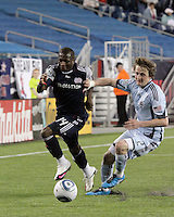 New England Revolution midfielder Sainey Nyassi (14) dribbles down the right field with Colorado Rapids defender Danny Earls (2) in pursuit.  The Colorado Rapids defeated the New England Revolution, 2-1, at Gillette Stadium on April 24.2010