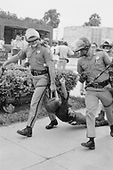 23 Aug 1972, Miami, Florida, USA --- Outside of the 1972 30th Republican Convention, police arrest 1000 demonstrators attempting to disrupt the event. Several thousand Women's Lib protesters demonstrate, led by Jane Fonda, were joined by the Vietnam Veterans to speak out against the war. --- Image by © JP Laffont   /Sygma/Corbis