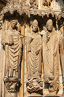 .South Porch, Right Portal, Left Jambs c. 1194-1230,  Cathedral of Notre Dame, Chartres, France. From left to right they are .1) Laumer (also called Lomer or Laudomarus), a local saint who was founder and Abbot of the nearby monastery of Corbion in the 6th century..2) Pope Leo I, an influential early Pope.3) a figure that is either Ambrose or Thomas Becket . A UNESCO World Heritage Site. .