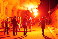 A protestor carries a flare in the street near Besiktas Stadium, Wednesday, June 5, 2013, in Istanbul, Turkey. (Seamus Travers/pressphotointl.com)