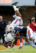 HAWGS ILLUSTRATED JASON IVESTER --08/30/2014--<br /> Arkansas sophomore running back Korliss Marshall is tackled by Auburn sophomore defesnive back Johnathan Ford and senior defensive back Jonathon Mincy on Saturday, Aug. 30, 2014, against Auburn at Jordan-Hare Stadium in Auburn, Ala.