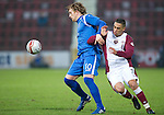 Hearts v St Johnstone...29.01.11  .Liam Craig battles with Suso Santana.Picture by Graeme Hart..Copyright Perthshire Picture Agency.Tel: 01738 623350  Mobile: 07990 594431
