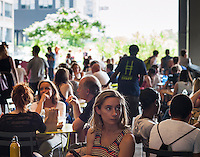 Visitors to the High Line Park in New York seek shelter from the sun during the heat wave, on Wednesday, July 17, 2013. The heat wave is expected to last for several more days, finally breaking on Saturday.  Meanwhile, the city has issued a heat advisory and has opened up cooling centers in all five boroughs ( © Richard B. Levine)