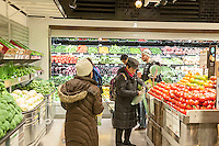 Shoppers in the produce department in the new Whole Foods Market opposite Bryant Park in New York on opening day Saturday, January 28, 2017. The store in Midtown Manhattan is the chain's 11th store to open in the city. The store has a large selection of prepared foods from a diverse group of vendors inside the store.  (© Richard B. Levine)