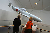 "'OHKA' SPECIAL ATTACK PLANE-'CHERRY BLOSSOM' ON DISPLAY AT YASUKUNI-JINJA SHRINE, TOKYO.  This kamikaze plane was used against US forces in the battle for Okinawa. Yasukuni Shrine is home to the spirits of the Japanese WWII war dead including ""kamikaze' pilots who all agreed to meet there in the ""afterlife"", beside the second cherry blossom tree on the right as you enter the shrine.. Shrine is controversially visited by Prime Minister Koizumi each year."