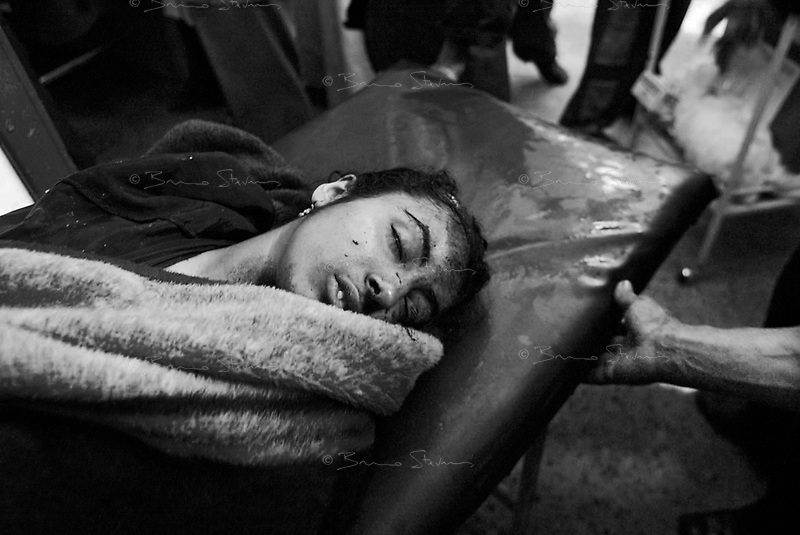 Baghdad, Iraq, April 5, 2003.A wounded teenage girl rushed to Al Kindi hospital emergency ward. More than 70 US bombardment victims were admitted in less than 2 hours after a B52 carpet bombing on the Northern outskirts, about a fifth of these were military personel.