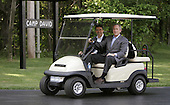 Camp David, MD - June 9, 2006 -- United States President George W. Bush and Prime Minister Anders Fogh Rasmussen of Denmark ride in a golf cart after the Prime Minister arrived at the Presidential retreat in Camp David, Maryland Friday 09 June 2006. President Bush plans to mix discussions on international issues with outdoor exercise as he hosts fellow fitness buff, the prime minister of Denmark, at Camp David..Credit: Shawn Thew - Pool via CNP