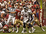 Denver Broncos quarterback Brian Griese (14) runs to get away from San Francisco 49ers linebacker Derek Smith (50) on Sunday, September 15, 2002, in San Francisco, California. The Broncos defeated the 49ers 24-14.  .