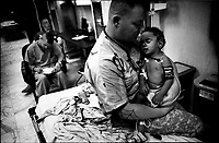 Sgt William Howard, a U.S. medic, holds an injured Iraqi boy brought to the emergency room of 28th Combat Support hospital in Baghdad August 21, 2007. The 28th Combat Support Hospital, based in Baghdad's fortified Green zone, is one of the busiest military emergency rooms in the world.