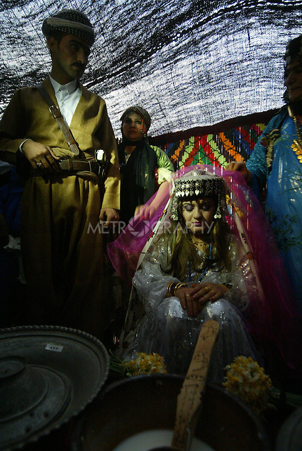 ERBIL, IRAQ: The bride and groom at a Kurdish wedding ceremony...Images from a traditional Kurdish wedding in Iraqi Kurdistan...Photo by Safin Hamid