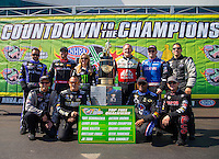 Sep 20, 2015; Concord, NC, USA; NHRA top fuel drivers (front row from left) Larry Dixon , Tony Schumacher , Antron Brown , Steve Torrence (back row from left) J.R. Todd , Shawn Langdon , Brittany Force , Doug Kalitta , Richie Crampton and Dave Connolly pose for a photo as the drivers competing for the championship during the Carolina Nationals at zMax Dragway. Mandatory Credit: Mark J. Rebilas-USA TODAY Sports