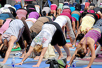 Participants do yoga at the Third Street Promenade during SmartwaterÕs Wanderlust Yoga In The City on Sunday, July 24, 2011...