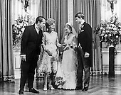 Washington, DC - June 12, 1971 -- From left to right: United States President Richard M. Nixon, first lady Pat Nixon; Tricia Nixon Cox; and Edward Cox are photographed in the receiving line in the East Room of the White House in Washington, D.C. after the formal wedding ceremony in the Rose Garden on Saturday, June 12, 1971.  More than 400 friends and guests attended the glittering affair that was partially marred by rain..Credit: Pool via CNP