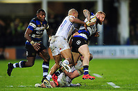 Tom Homer of Bath Rugby is tackled. Aviva Premiership match, between Bath Rugby and Exeter Chiefs on December 31, 2016 at the Recreation Ground in Bath, England. Photo by: Patrick Khachfe / Onside Images