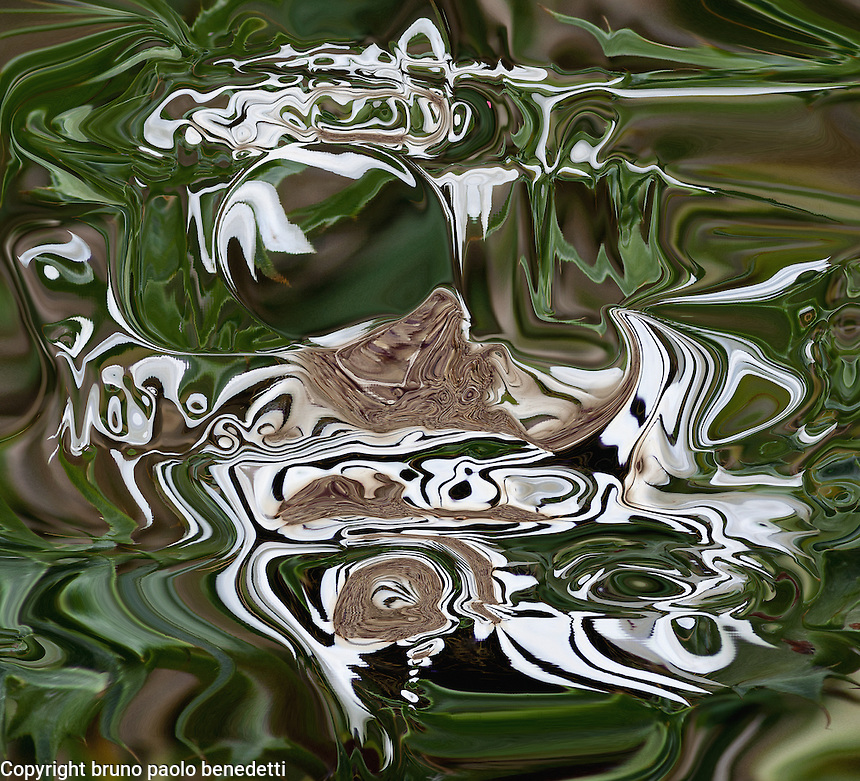 fluid abstractions in brown white and green color with shades. Non objective photography. Colors of the nature.