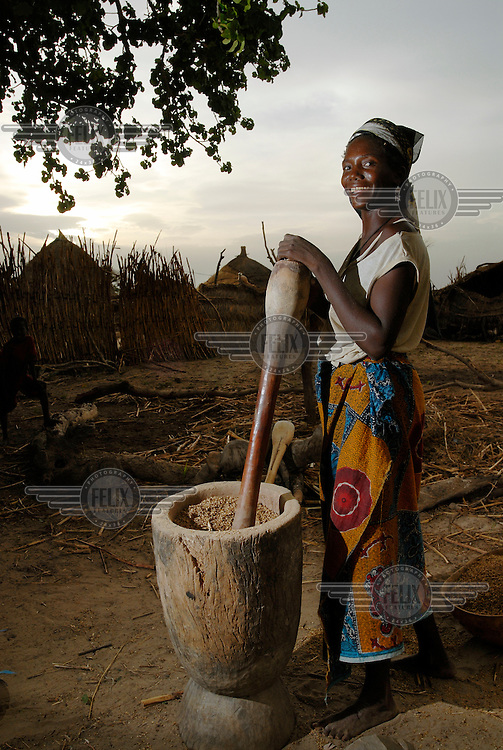 Nana Ado grinds millet in Damama village.