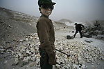 Yang Xinrun, 15, came to work in the Heilonggui Industrial District with his parents, after he finished second grade in primary school, and earns about 16 yuan a day. April 8, 2005.