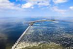 Nederland, Zeeland, Oosterschelde, 09-05-2013; Oosterschelde Stormvloedkering tussen Schouwen en Noord-Beveland met binnenkomend tij. Sluitgat Roompot  in de voorgrond, links de Noordzee. In het midden Neeltje Jans met werkhaven, Schouwen-Duiveland aan de verre horizon..Storm surge barrier in Oosterschelde (East Scheldt), between Islands of Schouwen-Duiveland and Noord-Beveland, North Sea on the left. Under normal circumstances the barrier is open to allow for the tide to enter and exit. In case of high tides in combination with storm, the slides are closed. .luchtfoto (toeslag op standard tarieven).aerial photo (additional fee required).copyright foto/photo Siebe Swart