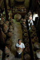Mr. Pisarn Boonphok in his museum of Pottery on Koh Kred Island.