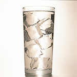 water in glass with ice cubes
