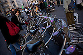 Paris, France.November 16, 2007..At a velib station (new public bicycles) at Place de la Republique struggling commuters ride bicycles at rush hour along side cars, trucks, motorcycles and scouters. The French public transport unions (SNCF, RATP) remained on strike for the third day in a major test for President Nicolas Sarkozy's reforms. They are protesting against the scrapping of pension privileges that allow some public employees to retire as early as age 50...