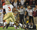 Jamoris Slaughter (26) holds on to the Seminoles quarterback EJ Manuel's shoe for a second quarter sack.