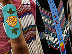 Close up of Native American Pow Wow Regalia. Examples of ethnic pride, heritage and traditional folk art crafts bead work.<br />
