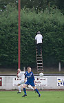 Linlithgow Rose 4 Pumpherston Juniors 0, 20/08/2008. Prestonfield Stadium, Dechmont Forklift League Cup. A groundsman retrieving a ball from a hedge as Linlithgow Rose, dressed in their change strip of white, take on local rivals Pumpherston Juniors at Rose's Prestonfield ground in a Dechmont Forklift League Cup group match which the home side won 4-0. Junior football was divided into East, West and North sections and played throughout Scotland. It had its own governing body, the SJFA and regional pyramid structure and national cup competition. Photo by Colin McPherson.