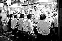 "Salarymen flock to a late night food stand in Tokyo. ""My husband always worked late and rarely ate dinner with family. He was absent from family life. We lived like a single-mother household"" says Kinmi Ohashi, 60, whose husband, Hitoshi committed suicide."