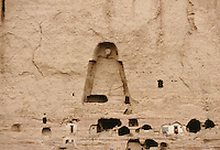 The niche of the 8 meters high Bamiyan Buddha statue surround by monasteries, temples, habitations in 1999..These magnificent colossal statues, created during the 3rdâ4th centuries A.D., attracted pilgrims for centuries, far beyond the time when Buddhism languished in India following the disastrous visitation of the Hephthalite Huns in the 5th century, the subsequent resurgence of Hinduism, and the arrival of iconoclastic Islam in the 7th century..The entire niche was once covered with paintings dating from i he late 5th to the early 7th centuries.