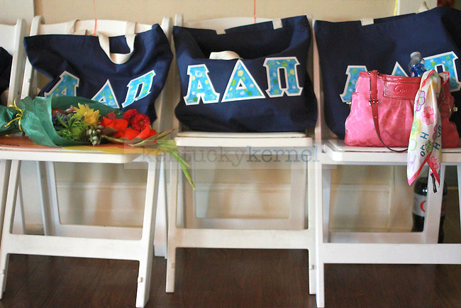 Sisters of the Alpha Delta Pi sorority placed bags emblazoned with their letters in a room in the sorority house. They celebrated this year's bid day, honoring their pledge class of 2010, on August 20, 2010.